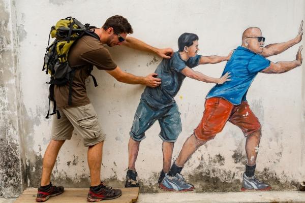 Murale w Georgetown: mężczyźni podpierający ścianę